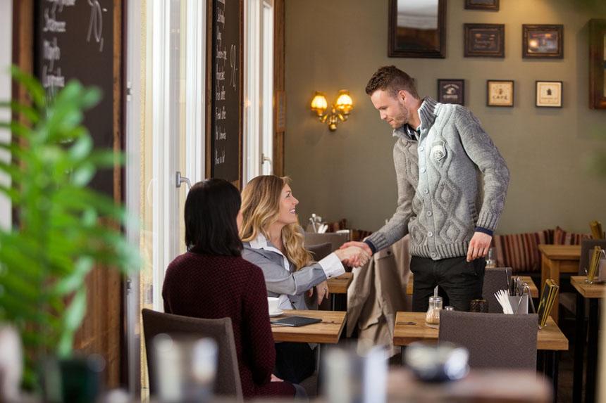 Man meets a woman in a restaurant
