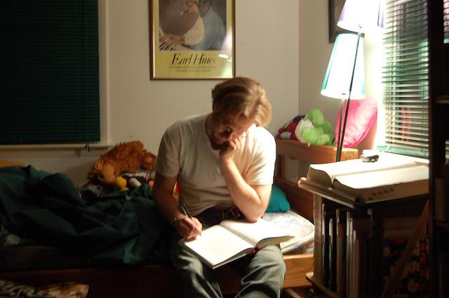 Man writing on his diary