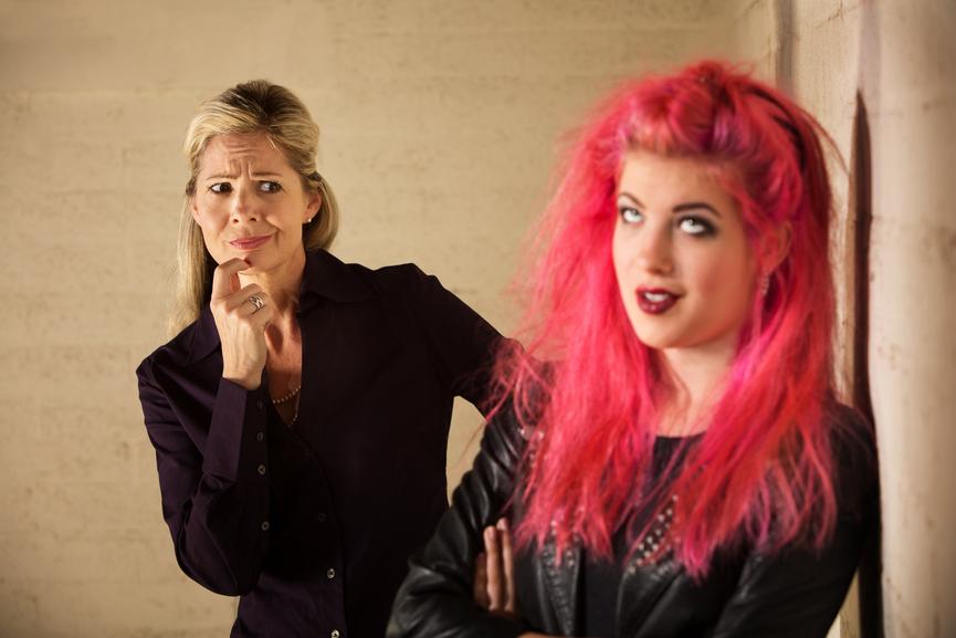 Woman judging a teenager
